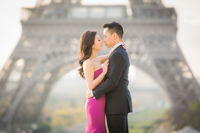 Portrait of a couple getting their engagement photoshoot in paris at Eiffel Tower