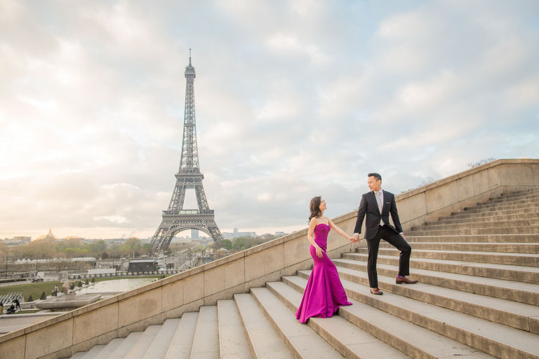 Couple walking up the stairs at Trocadero for their engagement shoot in Paris