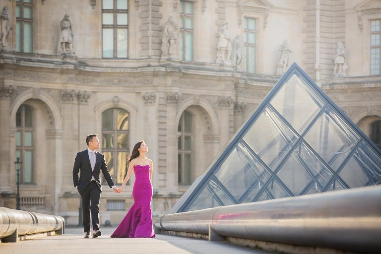 Couple walking in Paris for their engagement pictures