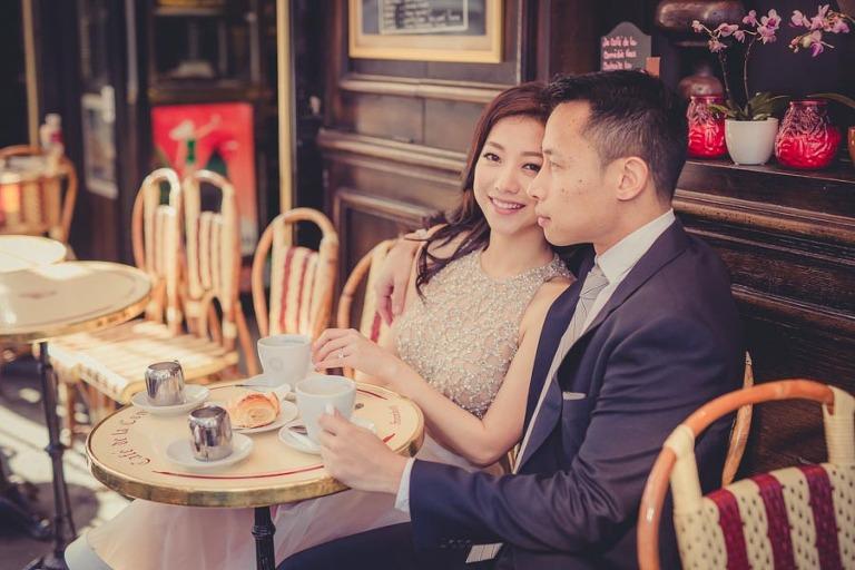 Portrait of a couple sitting at a café in Paris France