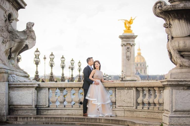 Engagement photo in Paris on a bridge