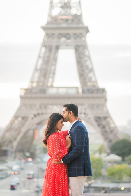 Couple kiss at Eiffel Tower