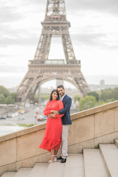 Portrait of couple in stairs at Eiffel Tower