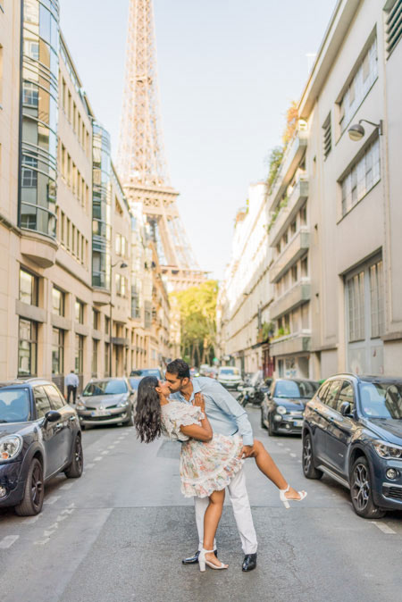 Couple in Paris streets, with Eiffel Tower