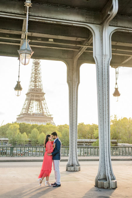 Eiffel tower photo from bridge with couple